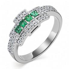 Кольцо из белого золота с бриллиантами и изумрудами